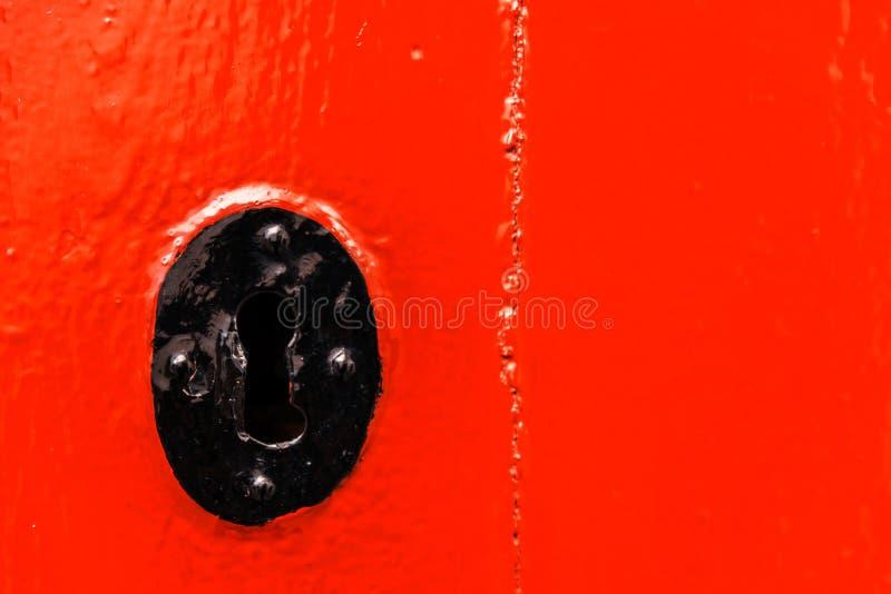 Keyhole w starym drzwi z ciekawą teksturą, szczątek fotografia royalty free