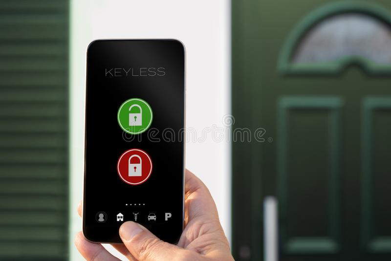 Keyless app smarphone open and close house door royalty free stock photography