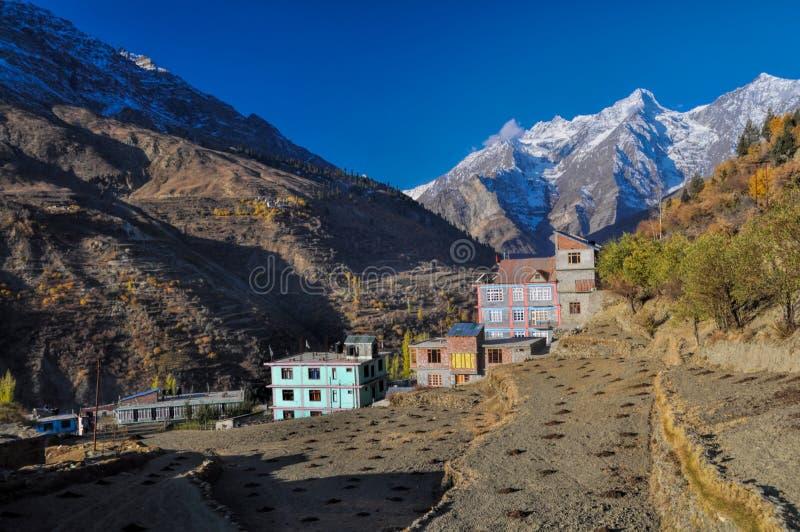 Keylog in Himachal Pradesh. Houses built in a gorge in Keylog in the setting sun, Himachal Pradesh stock image