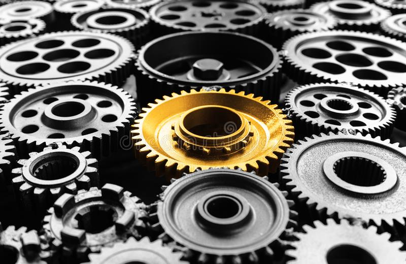 Keyman,key success or leadership concepts with metal gold cog outstanding in another cogs.Business performance royalty free stock image