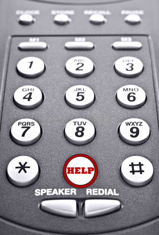 Keypad of a telephone with a red button for help royalty free stock photos