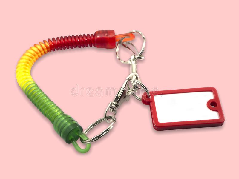 Keyring label is a red on a pink background. With clipping path stock photos