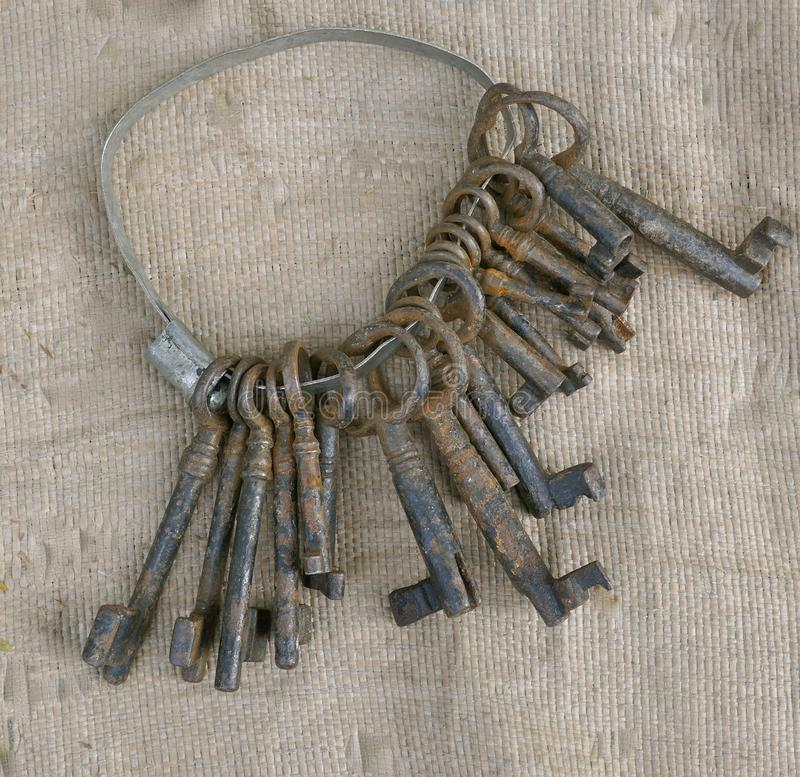 Keyring with some rusted old keys to sell at the flea market. royalty free stock photo