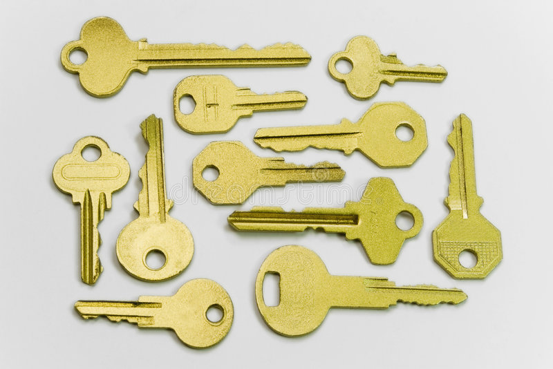 Keys. A lot of golden keys on white background stock photo