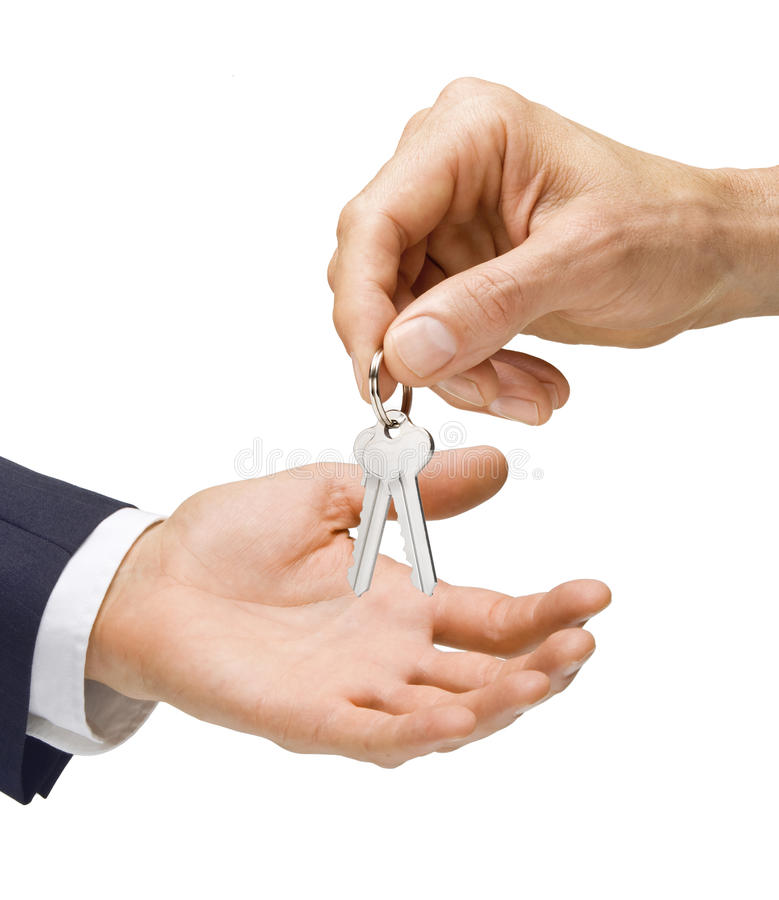 Keys Being Handed Over royalty free stock images