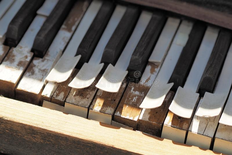 Keys of a desolate old weathered piano. Keys deteriorating on a desolate old weathered piano, Melbourne 2017 stock image