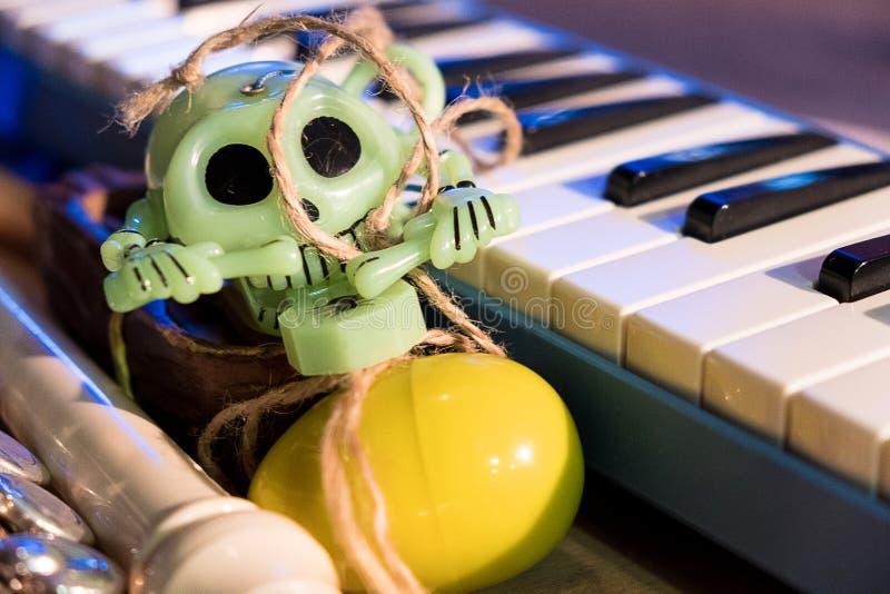 Keys and green skull toys stock photo
