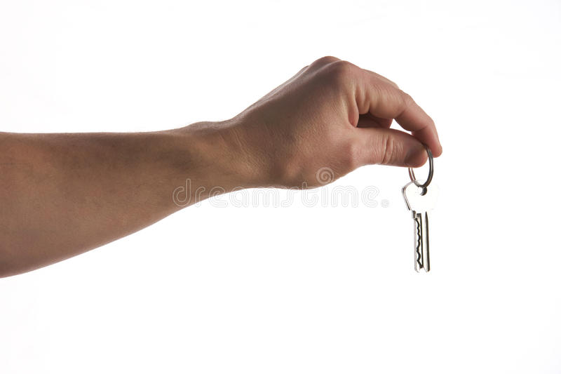 Keys in hand isolated on white royalty free stock photos