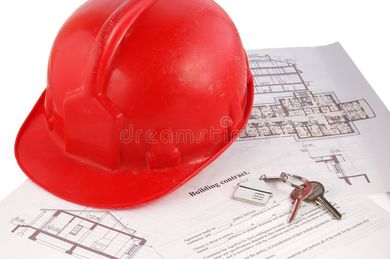 Keys and helmet on building contract stock photos