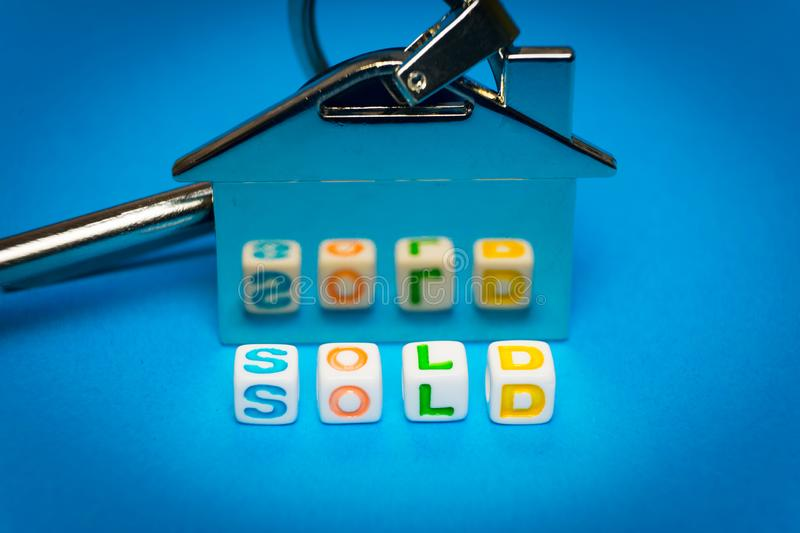 Keys with a keychain form the house and the inscription on the sale stock image