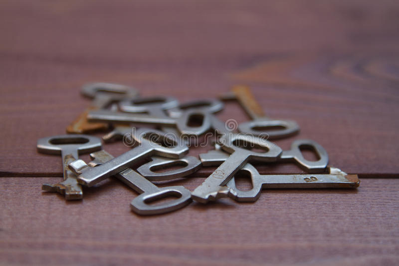 Keys locks on wooden background stock photography
