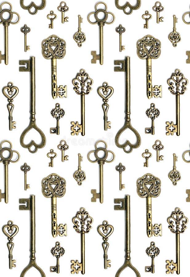 Keys pattern. Grunge old bronze keys pattern on white background stock photography