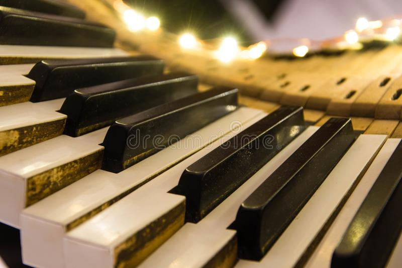 Old piano keyboard twisted with keys pushed down royalty free stock images