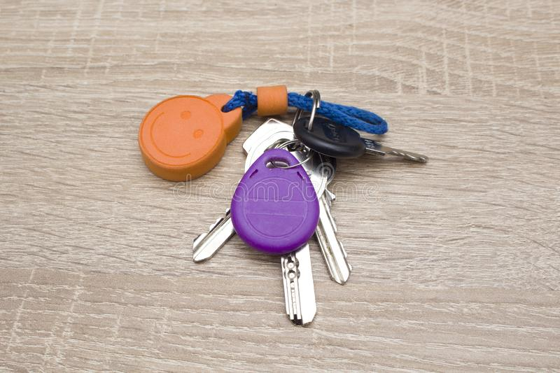 Keys and a rfid tag. On a key chain on a desktop stock photography