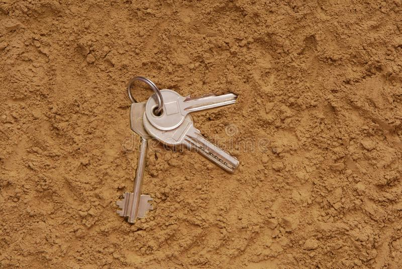 Keys are on the sand stock images