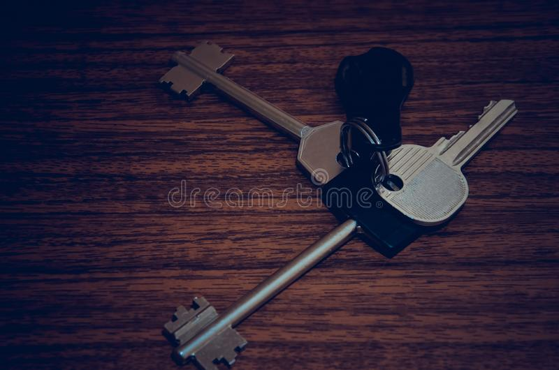 A bunch of keys to the apartment. The keys to the apartment on the table. Casually bloomed bundle of cuceae. Object key, Iron keys for mechanical lock stock images