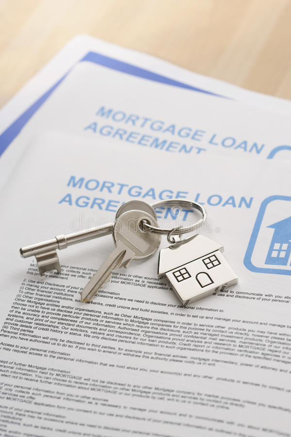 Keys to a New Home and mortgage papers on table stock photography