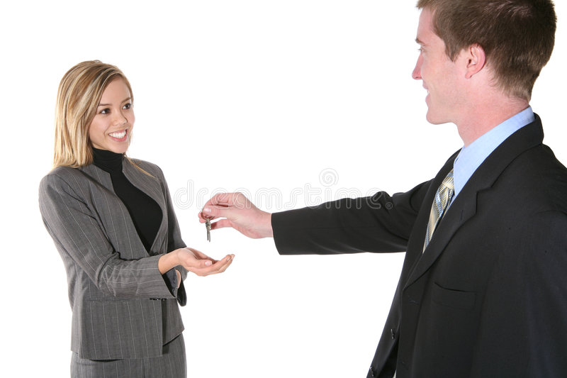 Keys to Success. A business man handing his partner the keys to success stock image