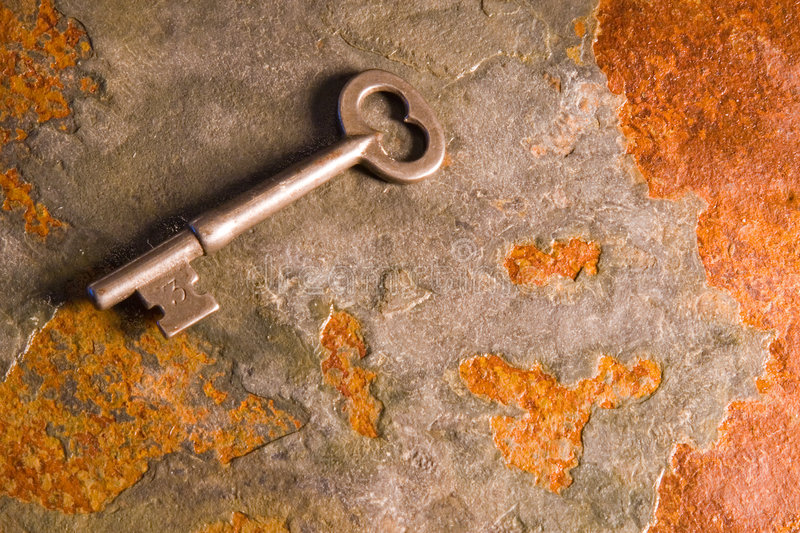 Keys to Success. Old skeleton type keys on a solid slate stone foundation stock photos