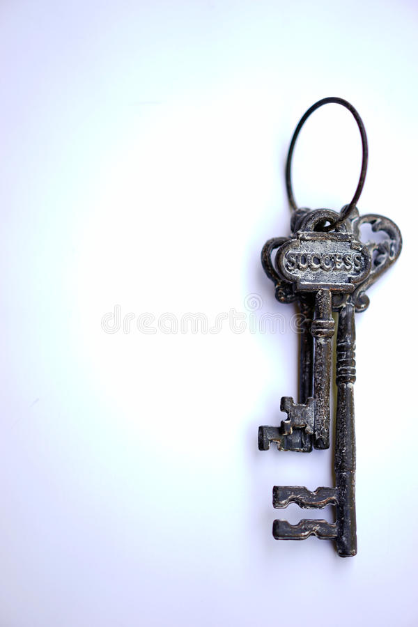 Keys to success - vertical. What does your key to success look like? These vintage keys may open the way to riches or secure a retirement stock photography