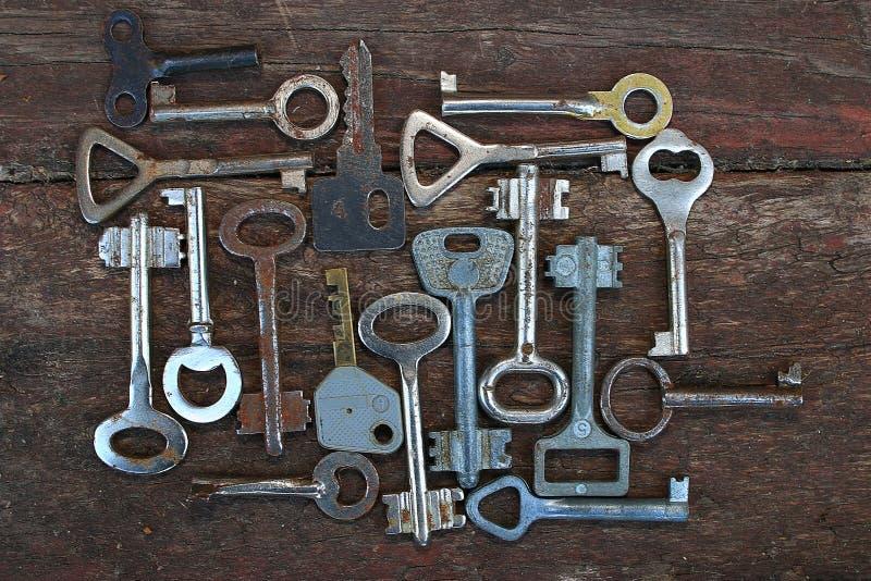 Keys on wooden background stock photography
