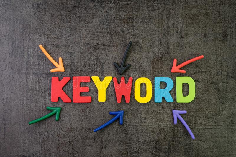 Keywords research for SEO, Search Engine Optimization, bidding on search result page to promote website online, multi color arrows. Pointing to the word Keyword royalty free stock photos