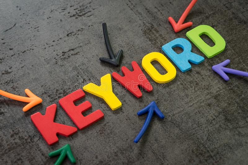 Keywords research for SEO, Search Engine Optimization, bidding on search result page to promote website online, multi color arrows. Pointing to the word Keyword royalty free stock photo