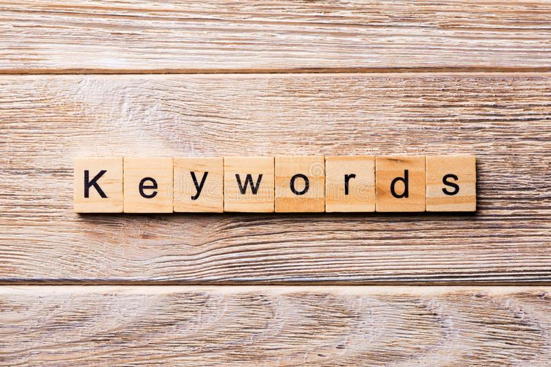 KEYWORDS word written on wood block. KEYWORDS text on wooden table for your desing, concept.  royalty free stock photos