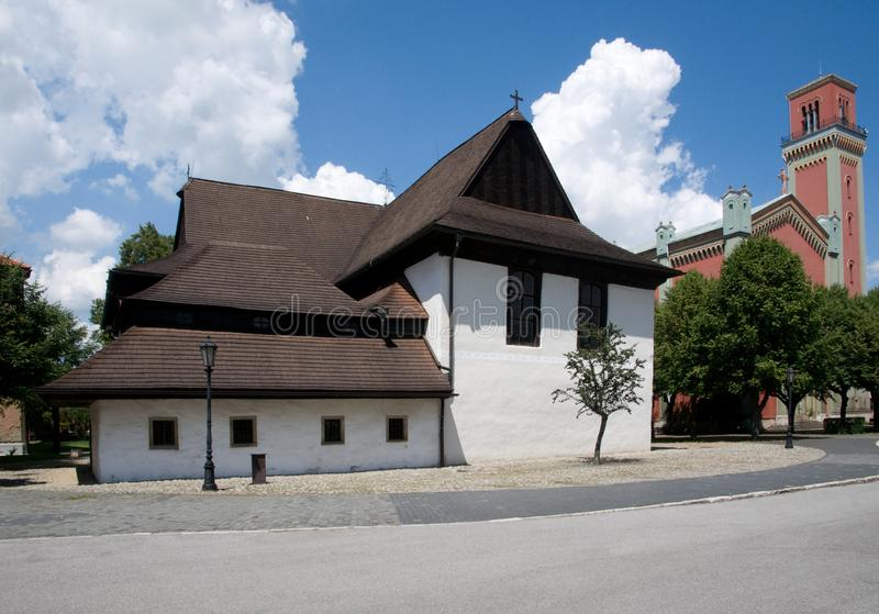 Kezmarok, Slovakia. Historic wooden church and modern church in town Kezmarok, northern Slovakia royalty free stock photography