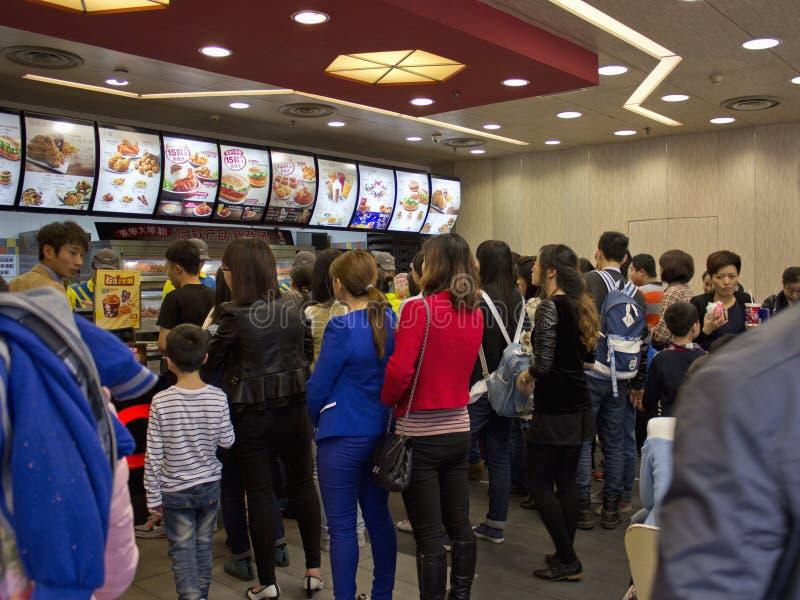 Kfc in China. KFC restaurant lines up to buy KFC food. The photo taken in Chongqing, April 6, 2014 royalty free stock image