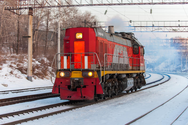KHABAROVSK, RUSSIA - JANUARY 06, 2017: Red diesel engine shunting locomotive on the railroad stock photo