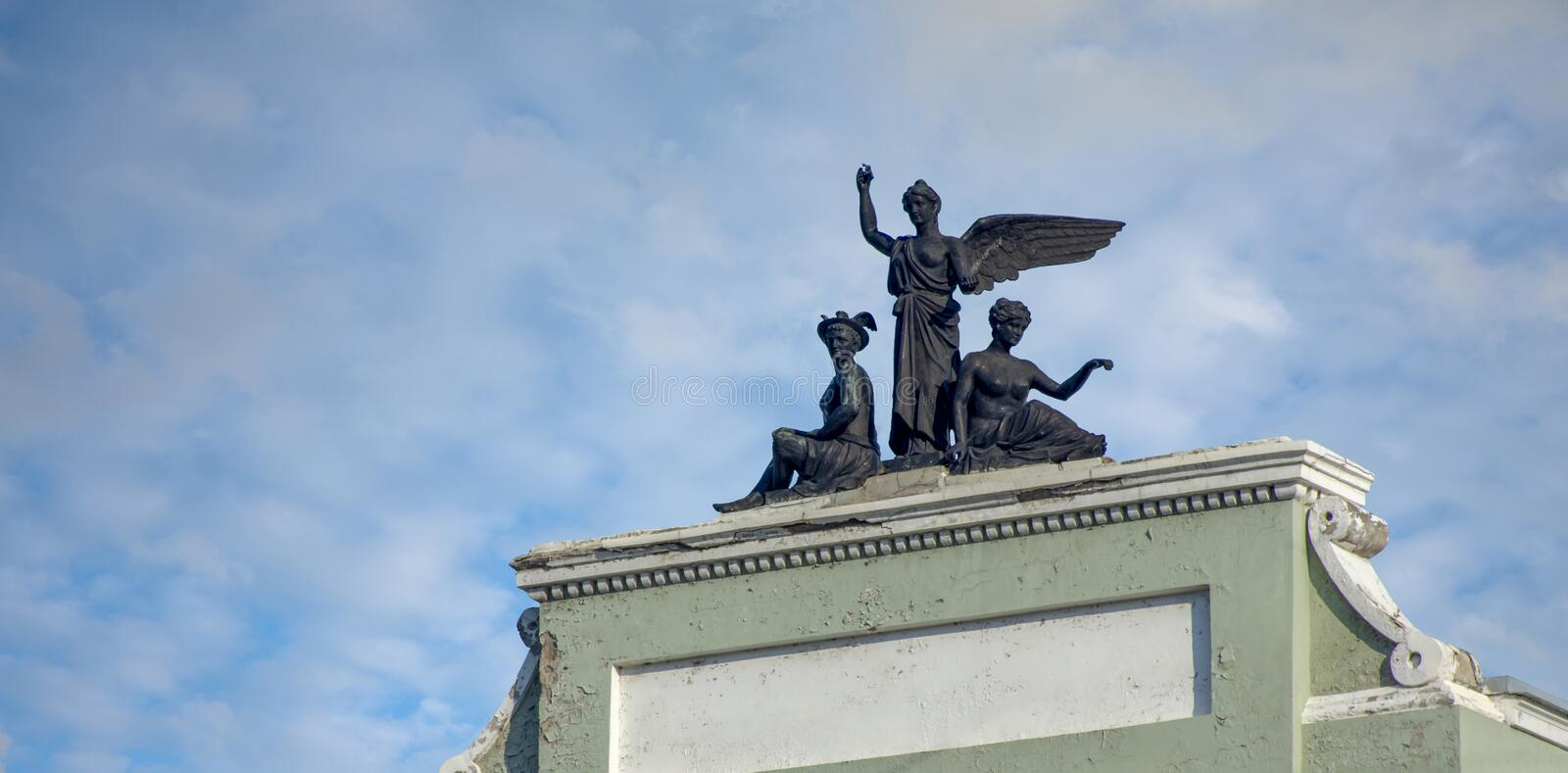 Khabarovsk. Sculptural group on the roof of the building 1906-1908 years of construction. Russia. Khabarovsk. Sculptural group on the roof of the building 1906 stock photos