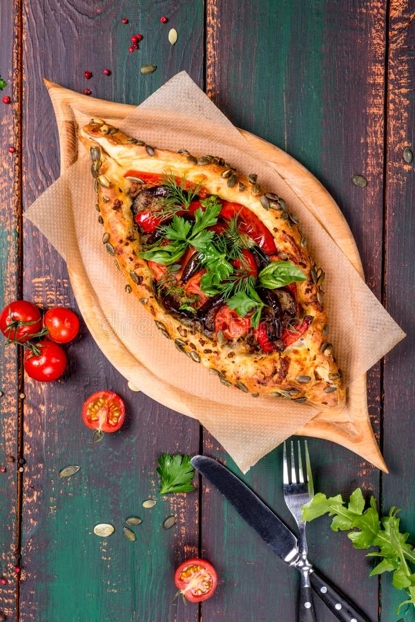 Khachapuri on a wooden green background from boards stock photos