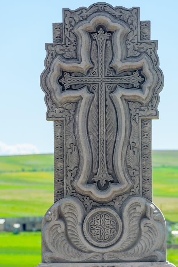 Khachkar Armenian gravestone på kyrkogården arkivfoto