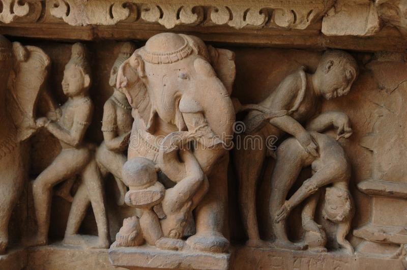 Erotic sculpture at Khajuraho Temple, India royalty free stock photo