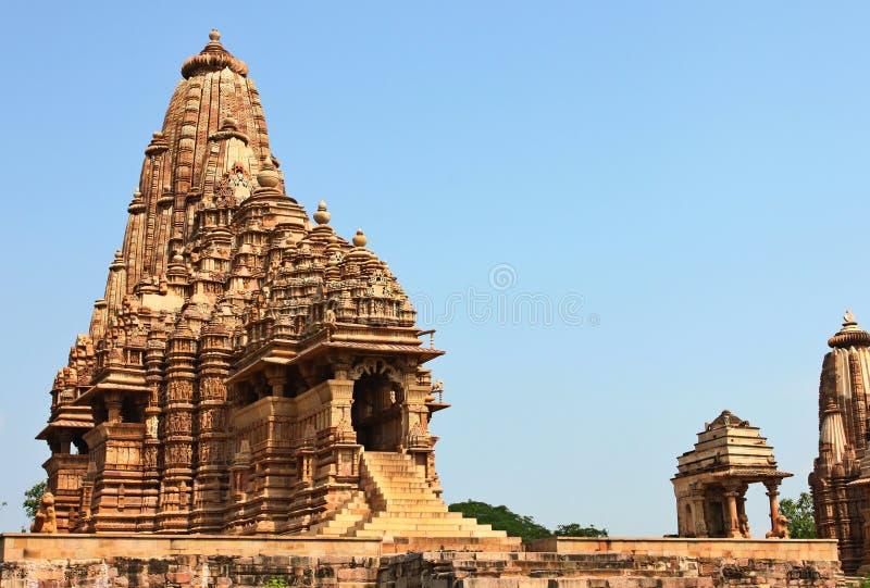 Khajuraho tempel och deras erotiska skulpturer, Indien royaltyfria foton