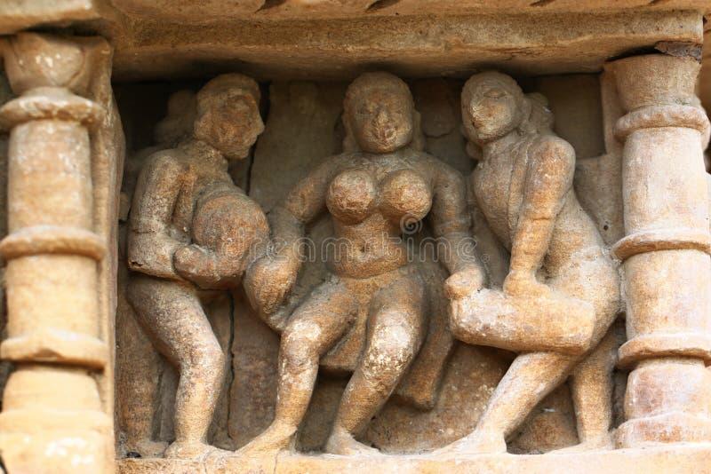 Khajuraho temples and their erotic sculptures, India. Khajuraho, India has manyl Hindu temples, famous for their erotic sculptures stock photos