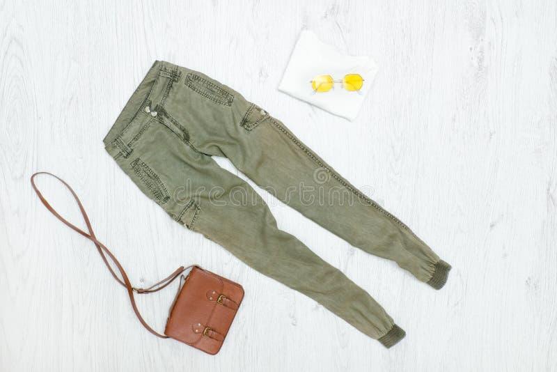 Khaki trousers, handbag and sunglasses. Fashionable concept stock image
