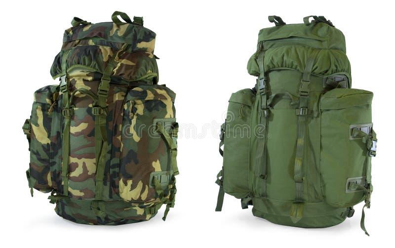 Khaki and woodland camouflage backpacks stock photos