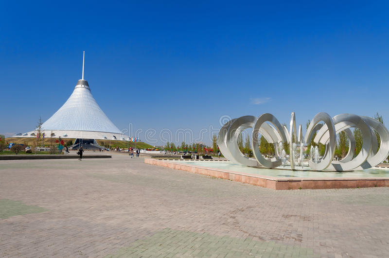 Khan Shatyr is a giant transparent tent and Fountain Horseshoe and Wheel in Astana. ASTANA, KAZAKHSTAN - MAY 10, 2014: Khan Shatyr and Fountain Horseshoe and royalty free stock photography
