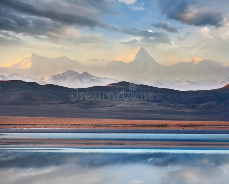 Khan Tengri mountain and Tuzkol lake. Beautiful View of highest peak in central asia Khan Tengri mountain with valley and lake Tuzkol in Kazakhstan stock photography