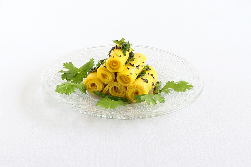 Khandvi indian vegetarian food stacked on a glass plate stock photo download khandvi indian vegetarian food stacked on a glass plate stock photo image of healthy forumfinder Choice Image