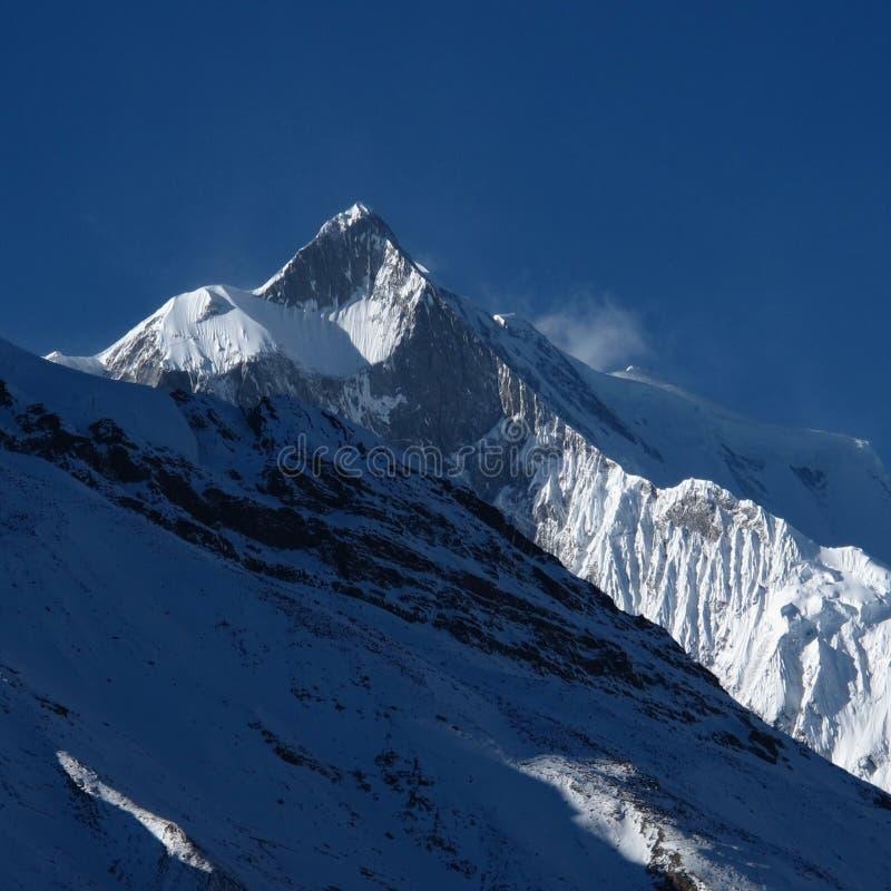 Khangsar Kang (roca Noir) los 7485m fotografía de archivo