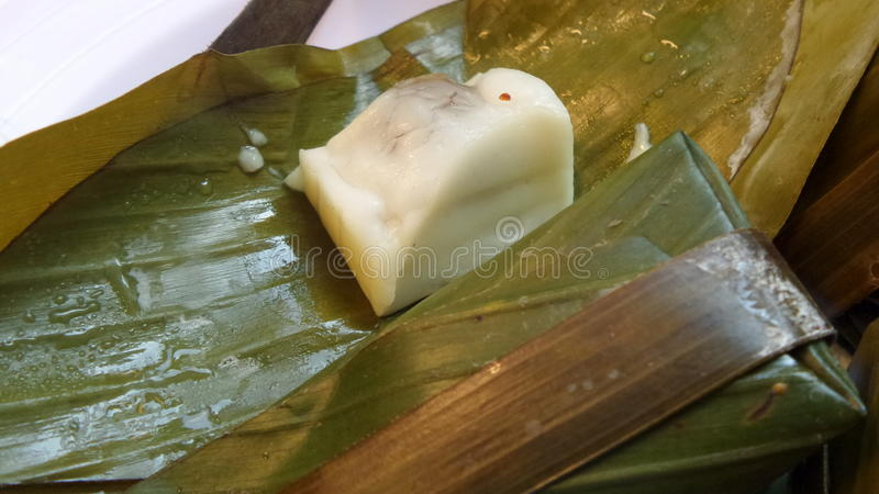 Khanom Sod-Sai Steamed Flour with Coconut Filling. Thai dessert wrapped with banana leaves stock photography