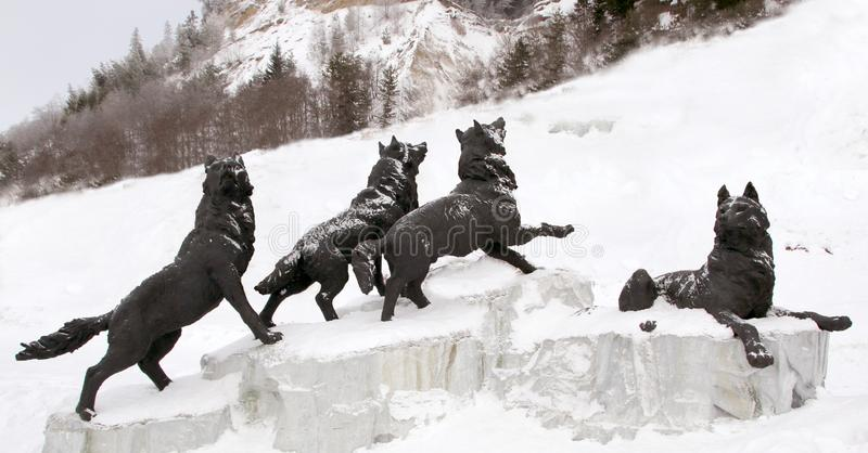 Pack of wolves sculpture , Archeopark,Khanty - Mansiysk, Russia Located at the foot of glacial hill, Archeopark shows lifelike sta royalty free stock image