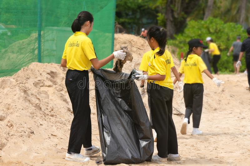 Khao Lak, Thailand, 1 june 2019: Asian kids Teens schoolchildren and boy scouts volunteers, girls and boys, clean up stock photography