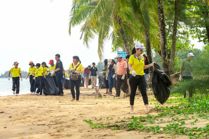 Khao Lak, Thailand, 1 june 2019: Asian kids Teens schoolchildren and boy scouts volunteers, girls and boys, clean up trash and. Clean up the beach from dirt and royalty free stock images