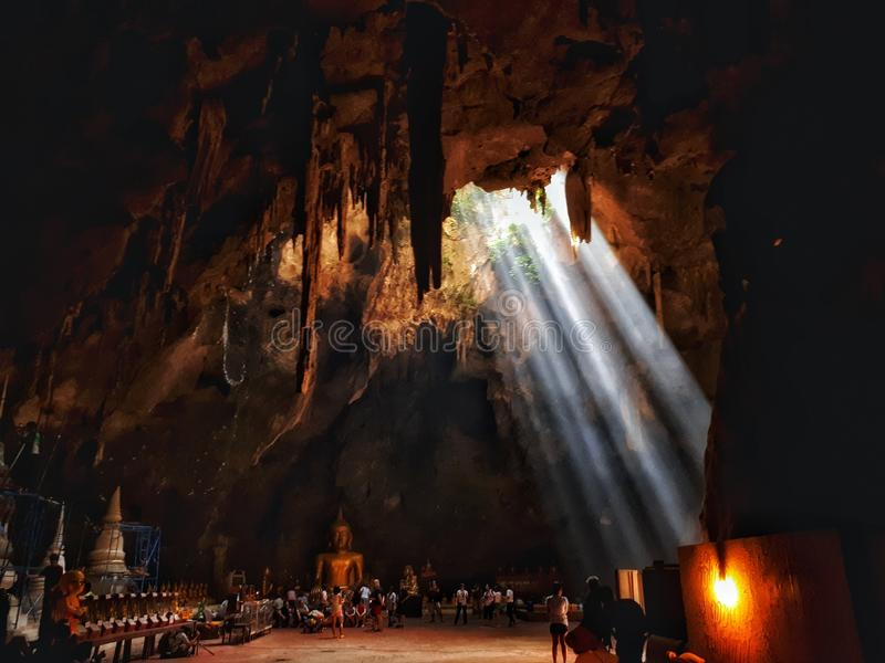 Khao Luang Cave in Thailand. Phetchaburi in Thailand .Tham Khao luang cave .Inside the Buddha is enshrined inside the cave.To see the sun shining down from the royalty free stock images