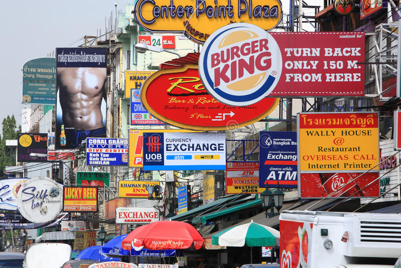 Khao San Road.Bangkok.thailand. A variety of signs for shops, restaurants, hub,spas, and internet cafes hang out of buildings. famous Khao San Road in Bangkok stock photos