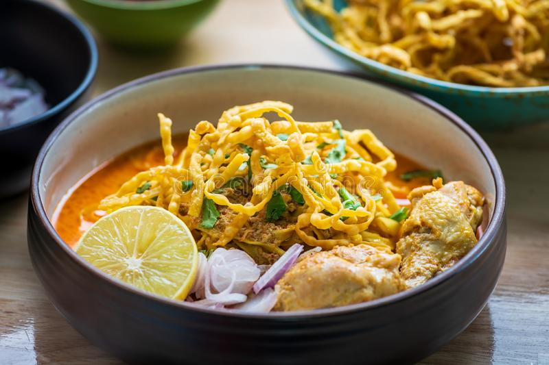 Khao Soi Kai, Northern Thai Noodle Curry Soup with Chicken. Close up of Khao Soi Kai, Northern Thai Noodle Curry Soup with Chicken royalty free stock images